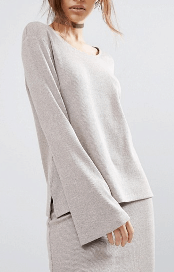 Neutral colored, long sleeved, flared tunic