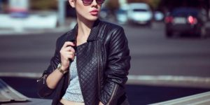 Woman wearing crop top and leather jacket