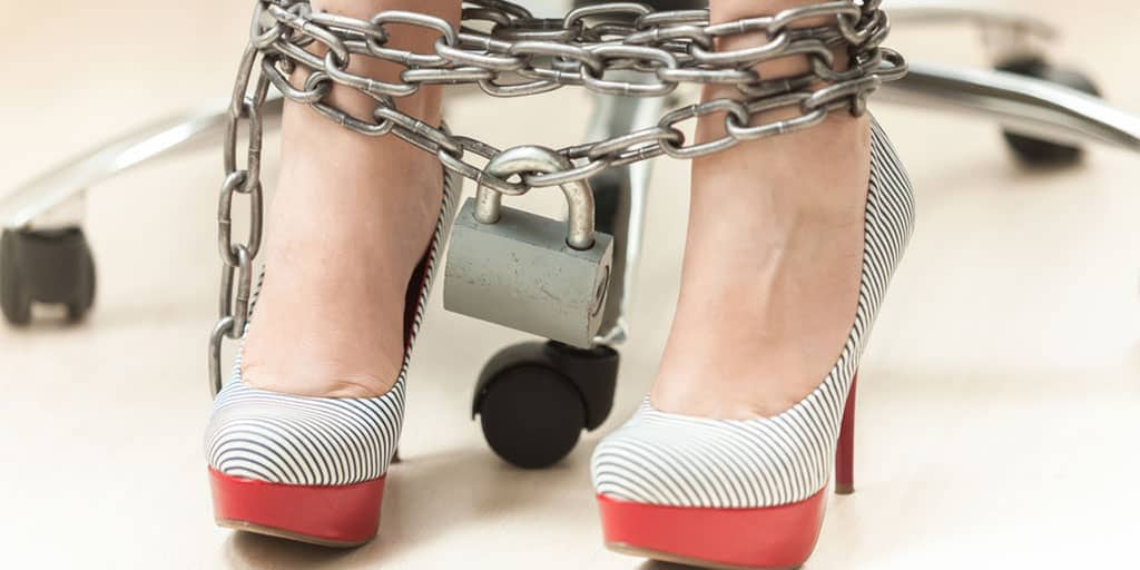 Woman wearing high heels with chains around her ankles