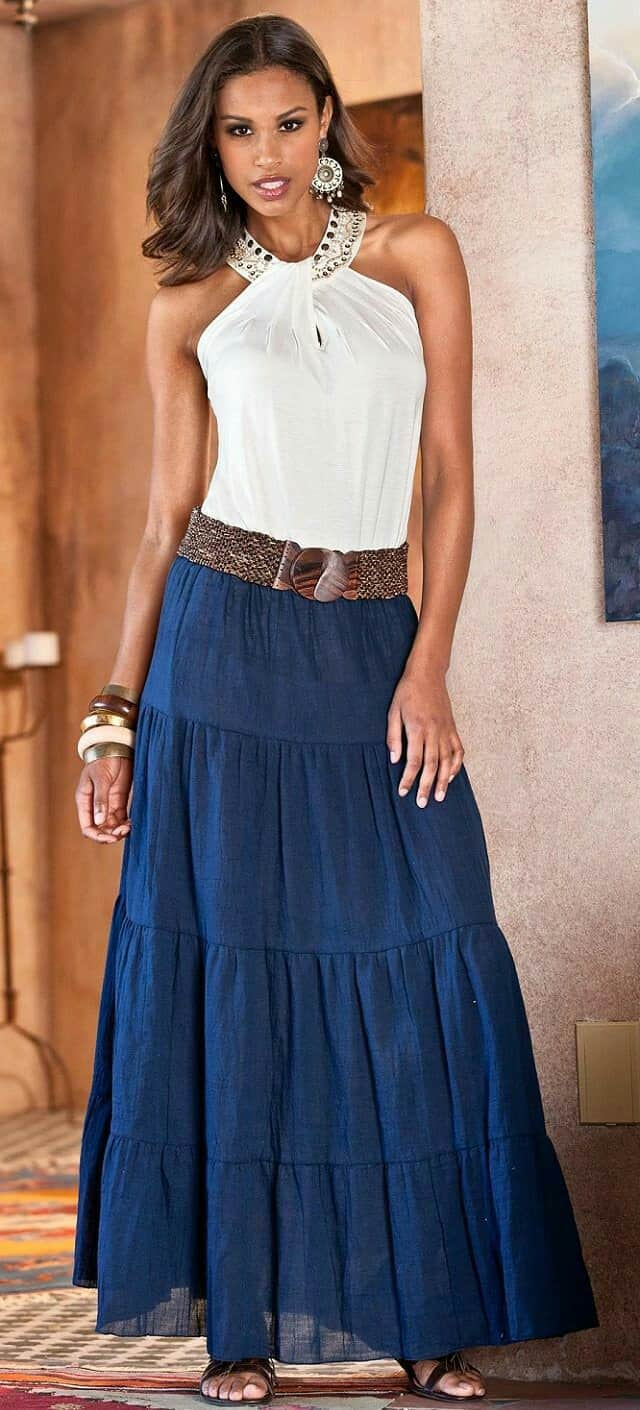 woman wearing blue long skirt and ivory embellished tank top