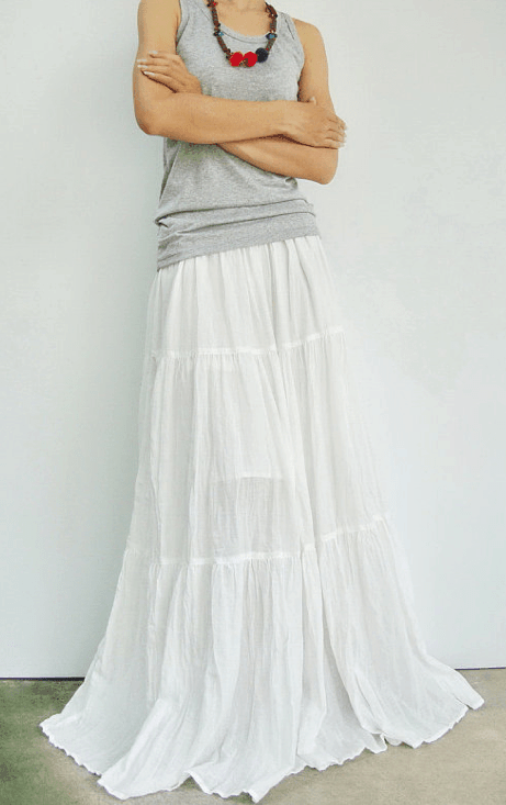 Long, white, tiered peasant skirt with fun necklace and gray tank