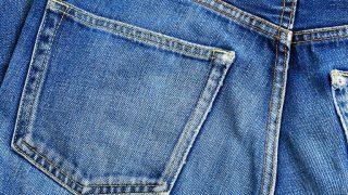 Close up of denim jeans' back pocket.