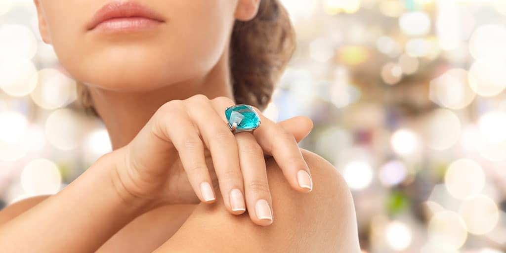 Woman wearing blue cocktail ring