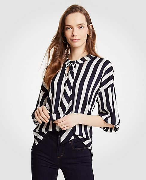 Black and white striped blouse with tie at the neck and puff sleeves