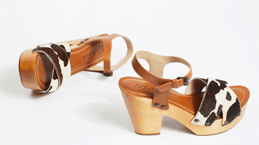 Clogs with cow print strap