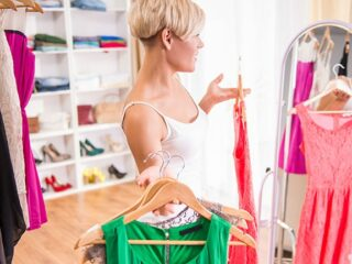Woman in her closet to represent closet organizing applications like Fashion-ade.