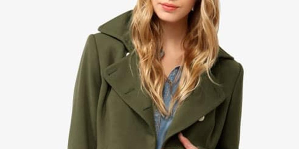 Woman wearing green military jacket