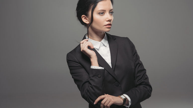 Woman wearing tuxedo jacket