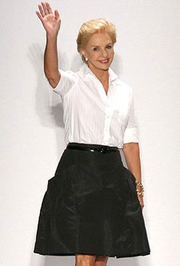 fashion for women after 60 -- Caroline Herrera in a classic white blouse and black, a-line skirt