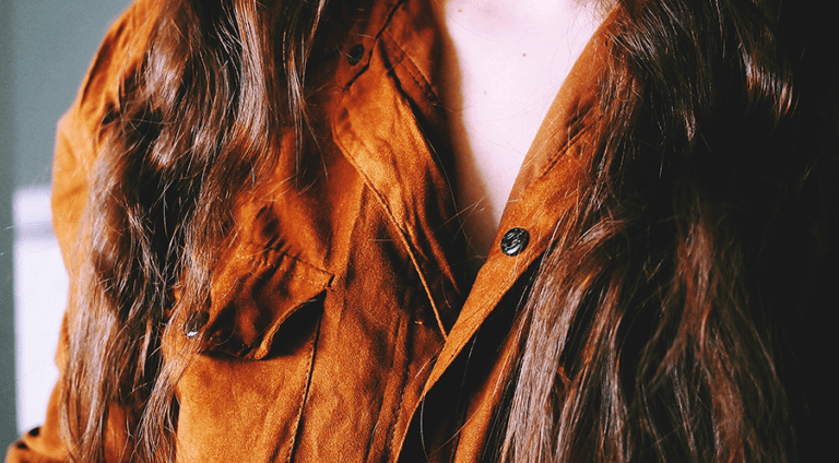 close up of woman wearing suede shirt