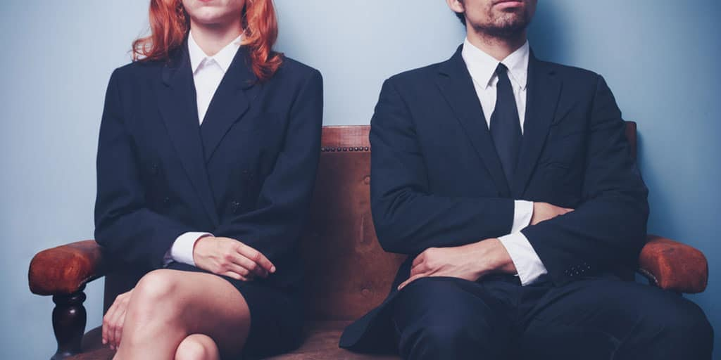 What to wear to a job interview - woman and man waiting for a job interview