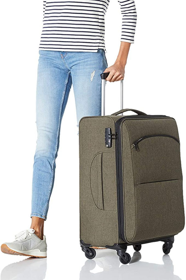 Woman rolling a budget-friendly hardside luggage bag