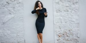 Woman wearing tight black dress