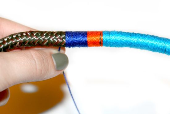 Alternating colors of thread wrapped around rope