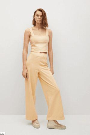 Pastel yellow pants by Mango.