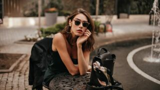 Girl wearing fashionable slip dress and sunglasses.