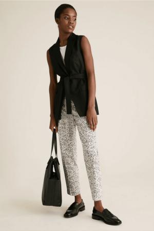 Model wearing printed pants.
