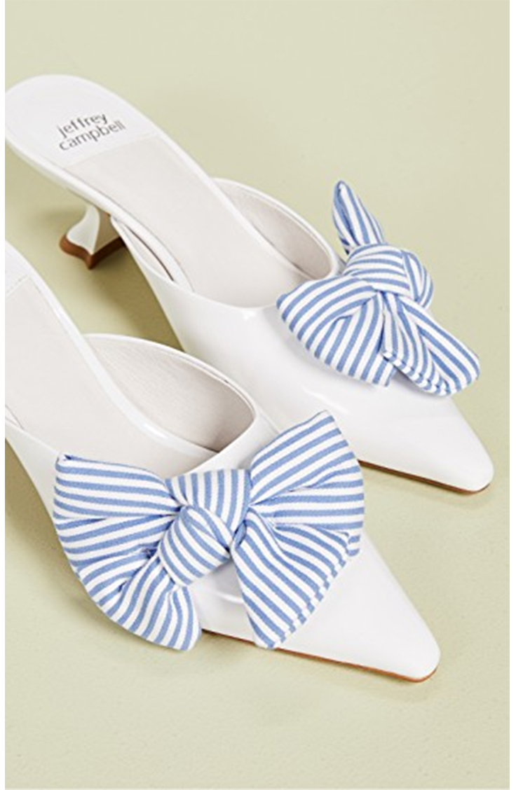 White kitten heels with blue bows