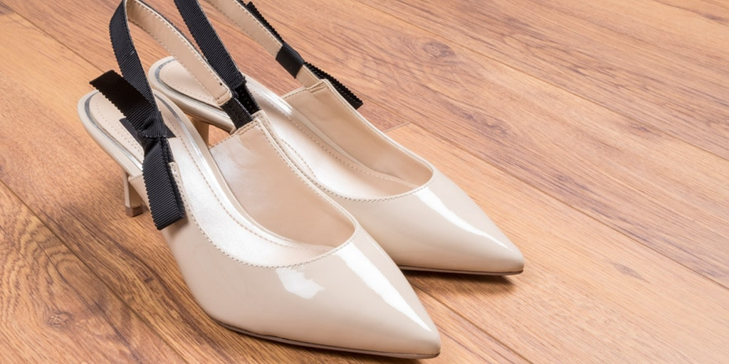 Pair of kitten heels on wood floor