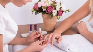 Close up of technician performing manicure