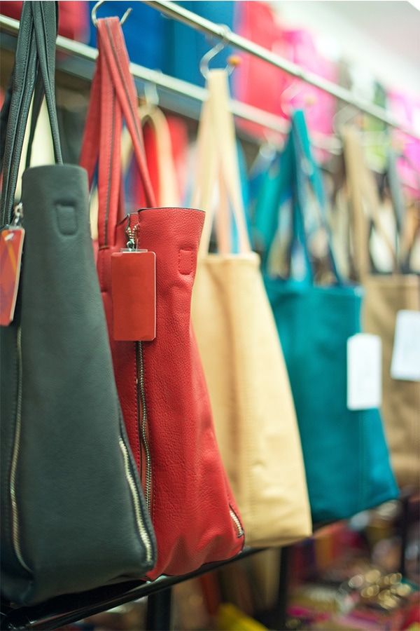 Purses hanging on store rack