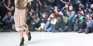 Runway model wearing designer clothing at a fashion show