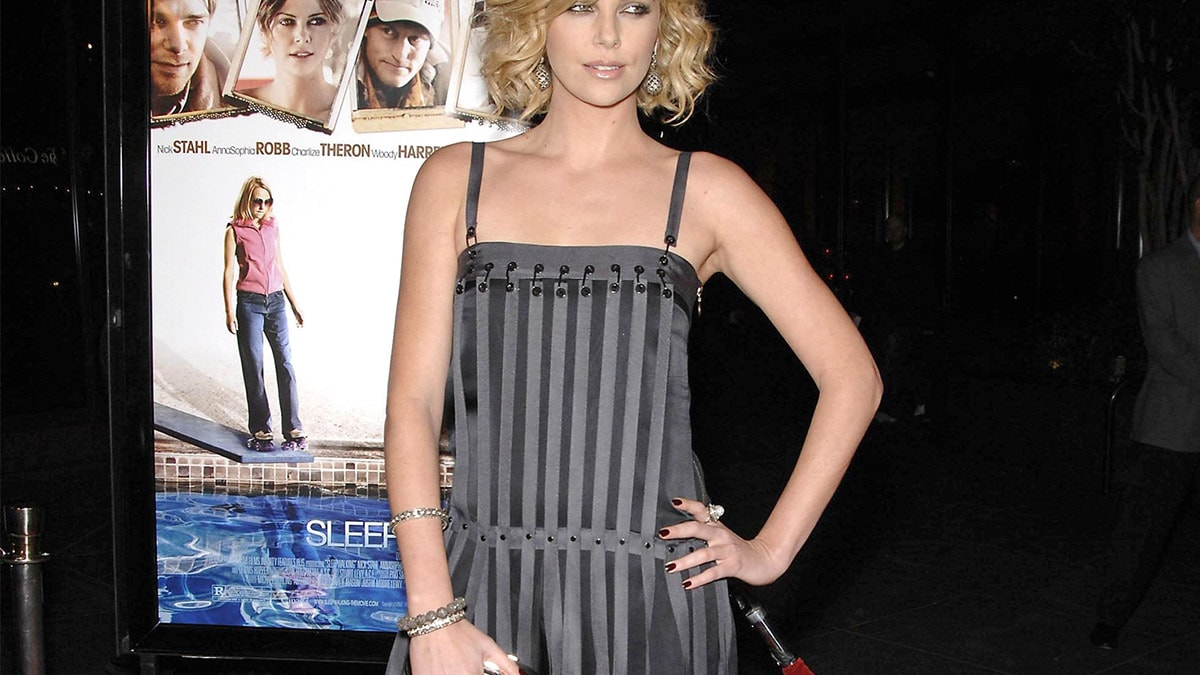 Charlize Theron wearing a drop waist dress