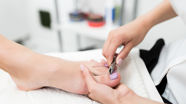 Close up of pedicure treament to represent pedicure safety tips.