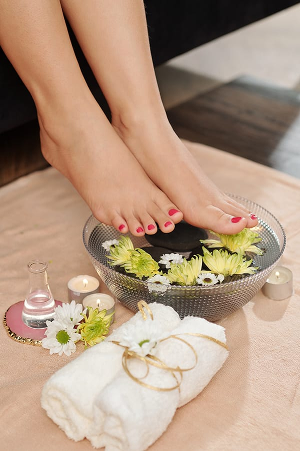 Close up of woman's feet just after giving herself a pedicure.