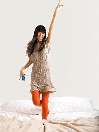 Woman Dancing on Bed
