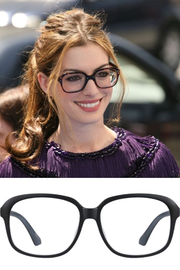 Anne Hathaway wearing oversized, square glasses.