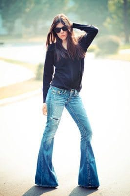 Woman wearing flared jeans