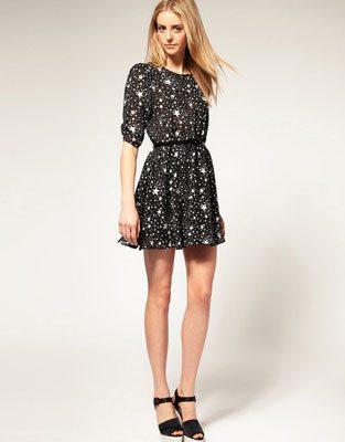 woman wearing short black dress