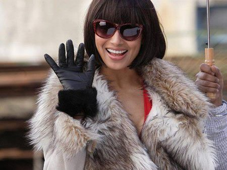 Woman wearing gloves and fur coat