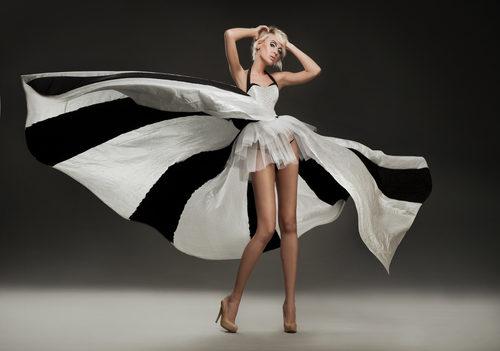 Woman wearing black and white dress.