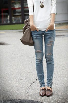 Girl wearing ripped denim and oxford shoes