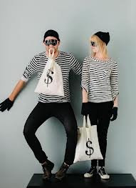 diy halloween costumes - man and woman dressed as bank robbers