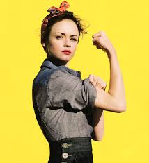 diy halloween costumes - woman dressed as rosie the riveter flexing her bicep