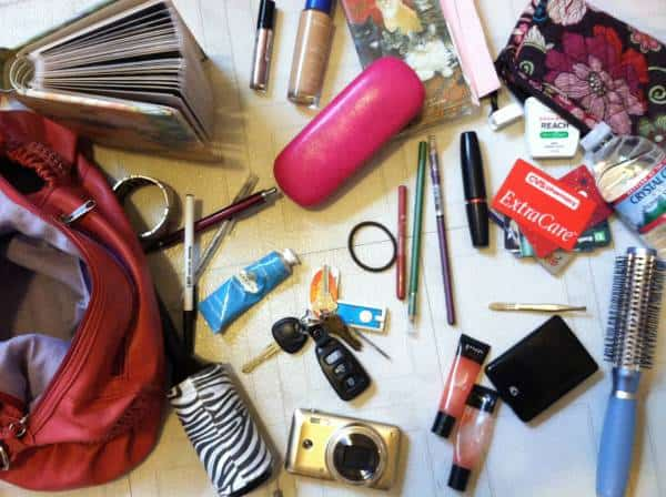 What 6+ pounds looks like in my purse: a camera, water bottle, lint roller, mini photo album (hey, it's good for some #ThrowbackThursday laughs) and of course, beauty products.