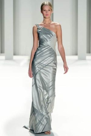 Woman wearing silver, one-shoulder gown