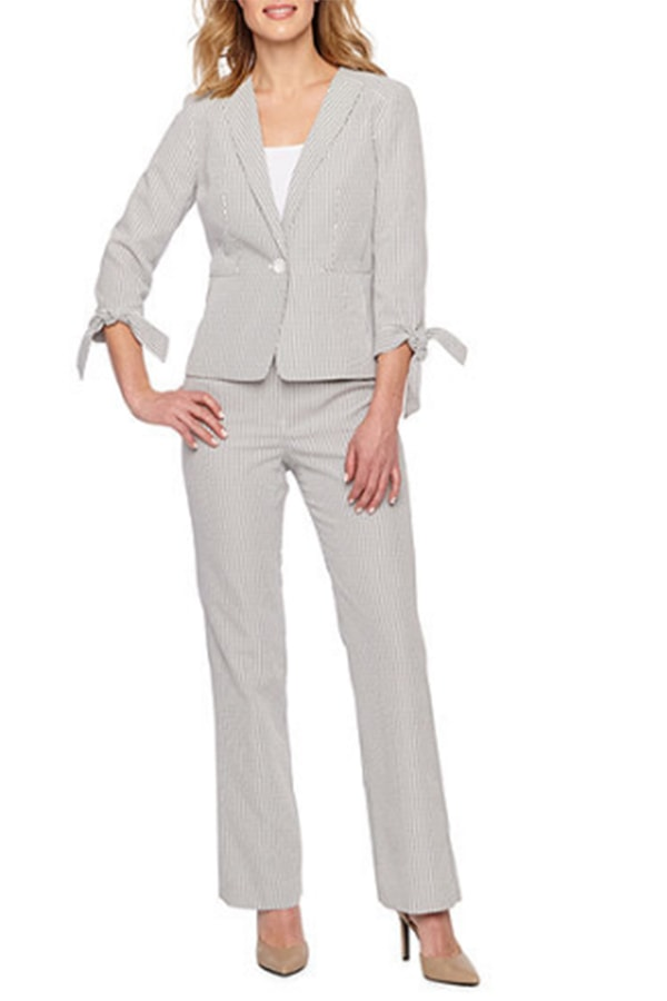 Woman wearing grey suit with tie sleeves