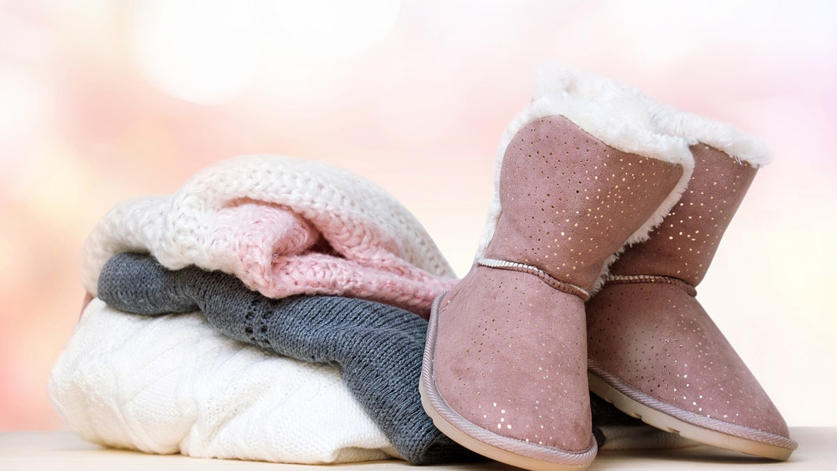Ugg boots with a pile of sweaters. I love Uggs!