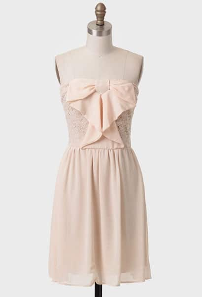 Light pink dress with bow detail on the front
