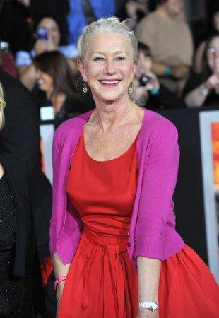 Helen Mirren wearing red dress and pink cardigan