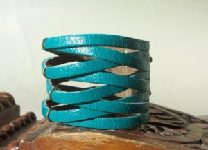 Cuff bracelets in leather show a cutout design in a different way.