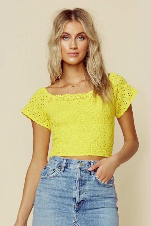 Woman wearing yellow crop top
