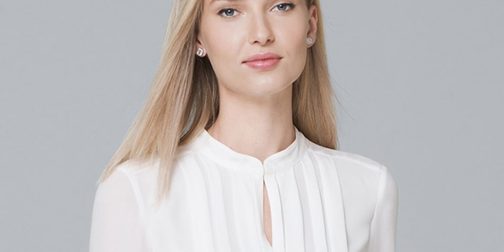 Woman wearing white pleated blouse