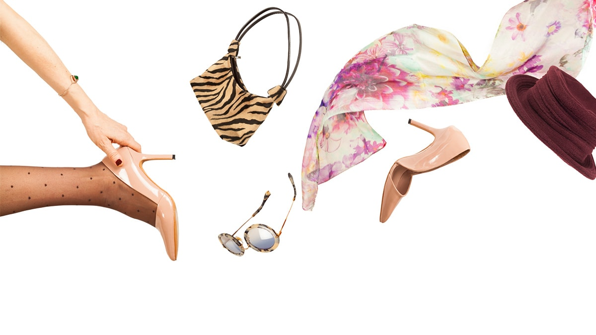 Fashion update - woman throwing flashy accessories