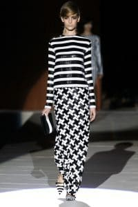 Runway model wearing mixed patterns