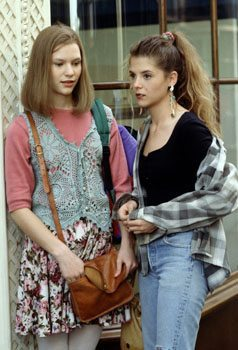 Two girls wearing plaid